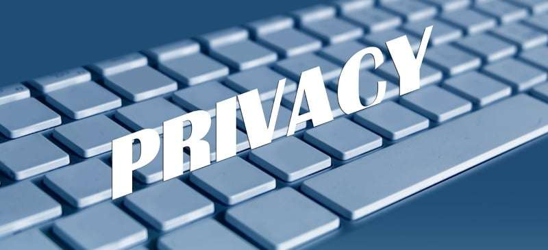 words privacy imposed over a computer keyboard - privacy policy soulmatewire.com